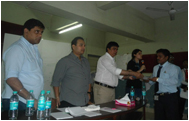 Supervisor being felicitated by Director for his good work